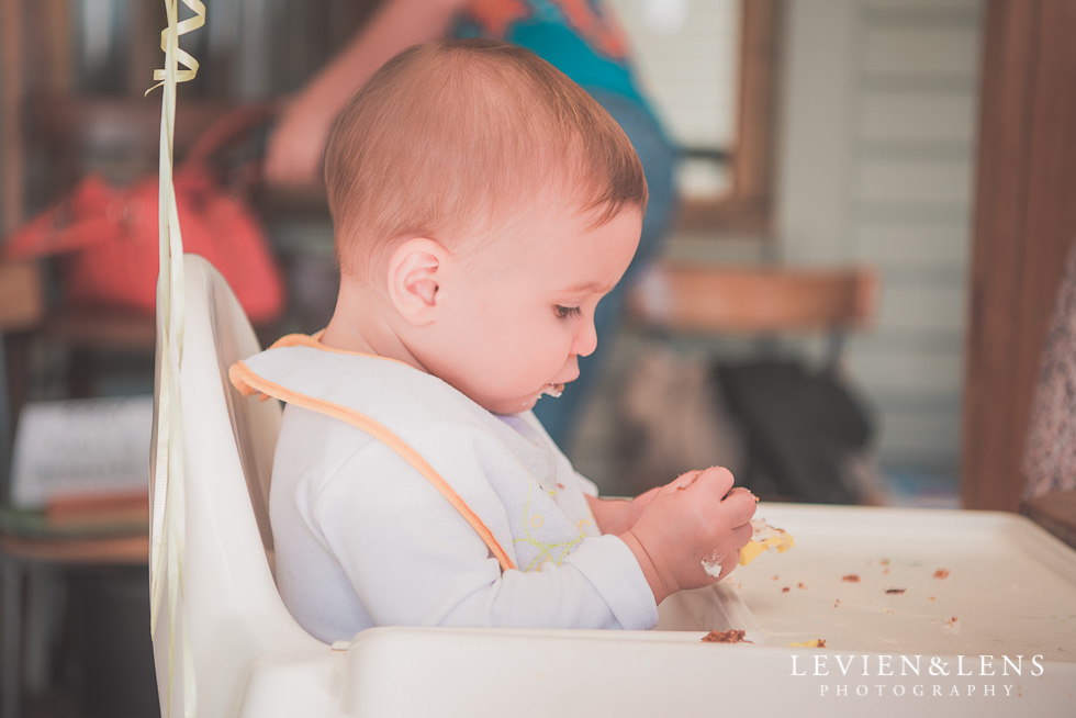 baby in high chair Butterfly Creek Minions birthday party {Auckland NZ event photographer} Nazar 1 year old