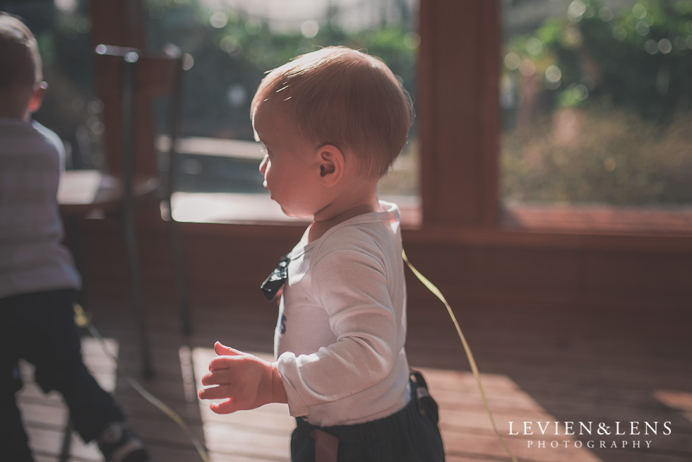 baby boy walking Butterfly Creek Minions birthday party {Auckland NZ event photographer} Nazar 1 year old