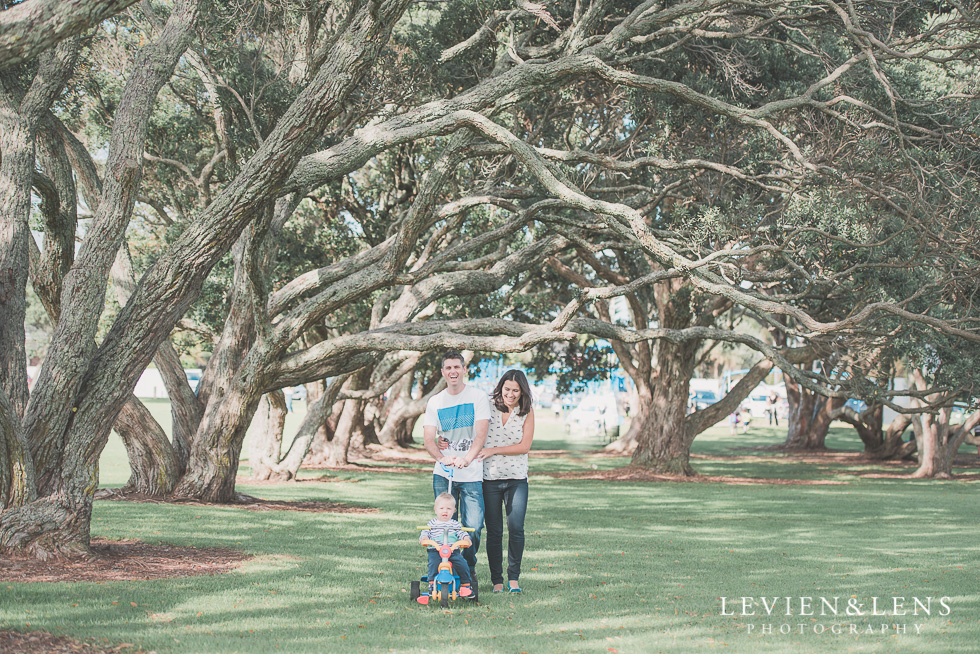 family of three walking in park Milford Beach family session {Auckland lifestyle photographer}