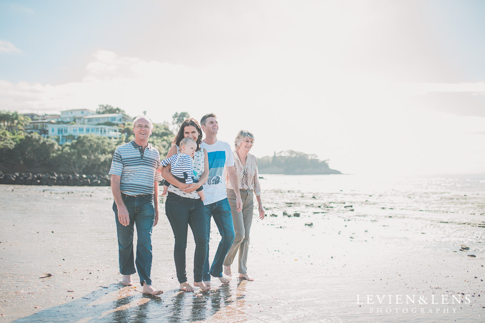 family with grandparents walking on seaside Milford Beach family session {Auckland lifestyle photographer}