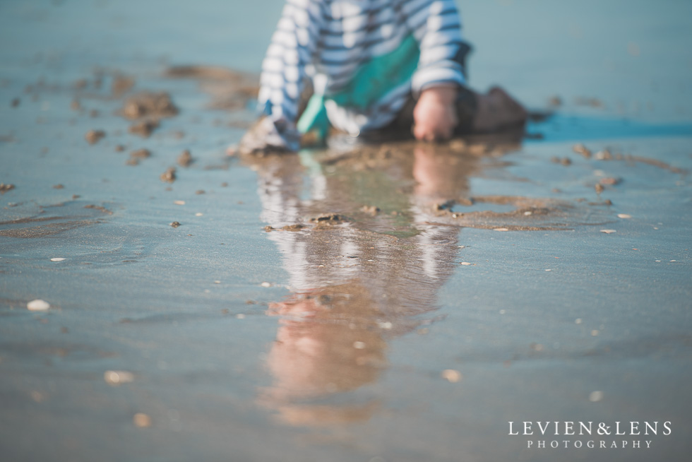 boy playing in sand Milford Beach family session {Auckland lifestyle photographer}