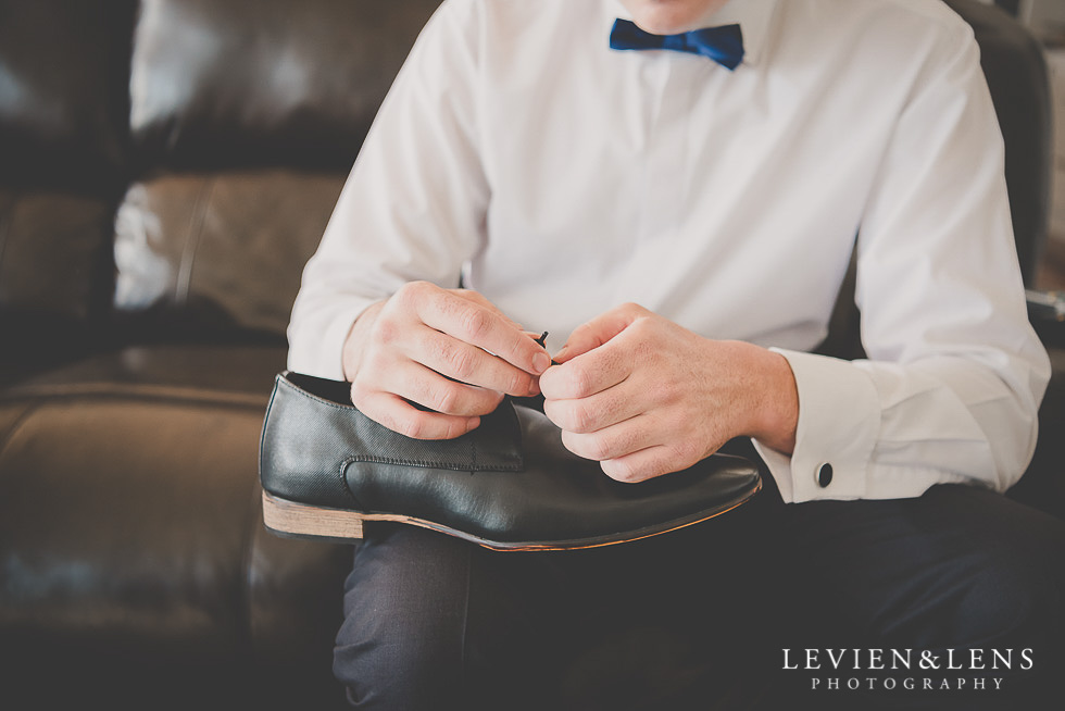 groomsmen holding shoes getting ready St Margarets Cafe - Karaka {Auckland lifestyle wedding photographer}