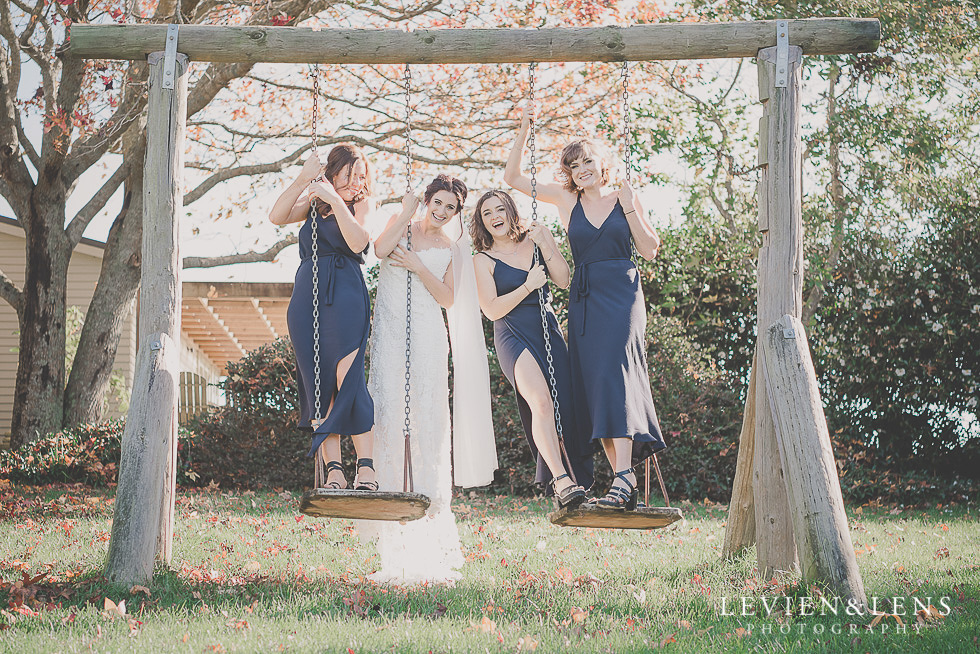 bride with bridesmaids on swing St Margarets Cafe - Karaka {Auckland lifestyle wedding photographer}