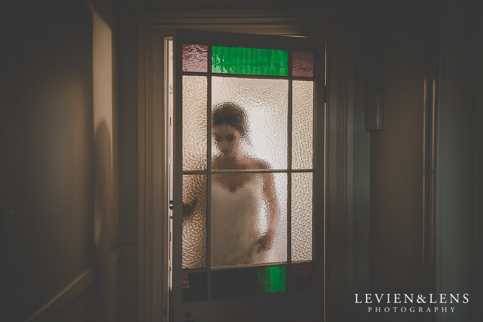 bride behind the door getting ready St Margarets Cafe - Karaka {Auckland lifestyle wedding photographer}