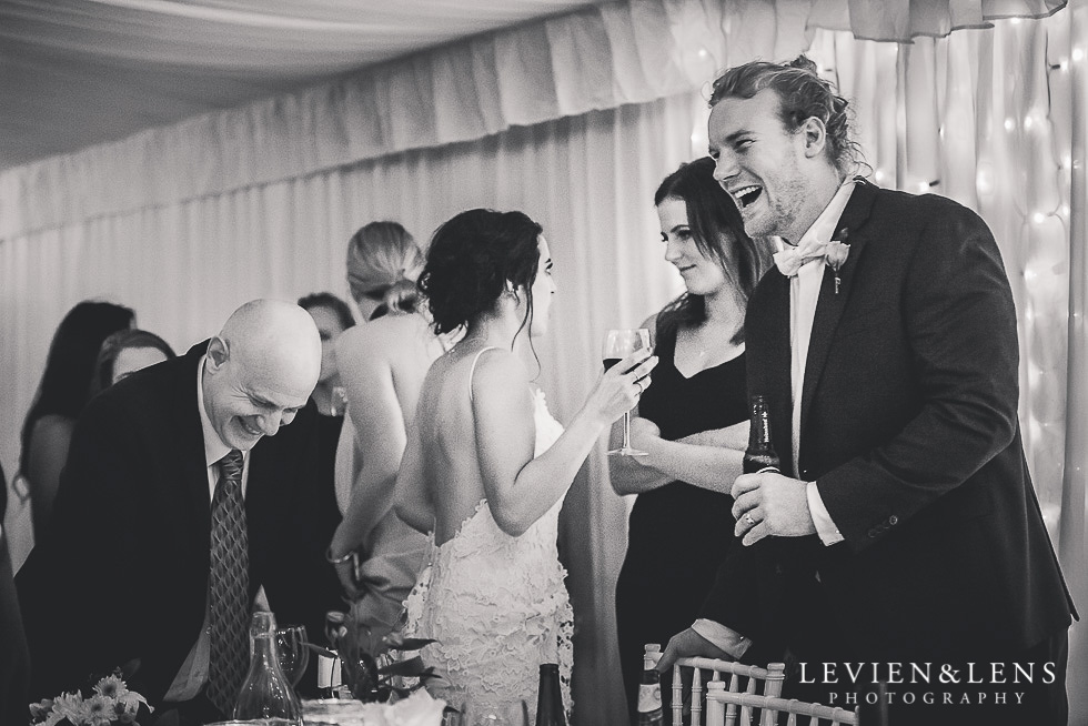 groom and brides dad laughing - reception St Margarets Cafe - Karaka {Auckland lifestyle wedding photographer}