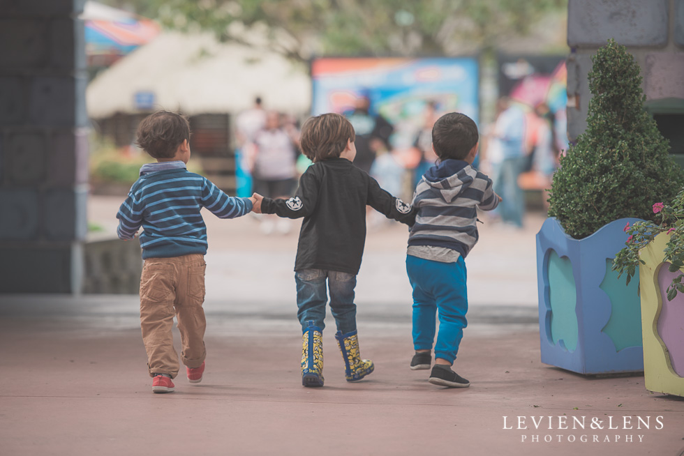 three boys holding hands - Rainbows End birthday party {Auckland lifestyle event-family-kids photographer}