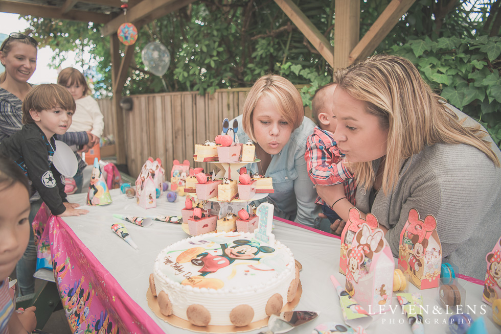 blowing candle - Rainbows End birthday party {Auckland lifestyle event-family-kids photographer}