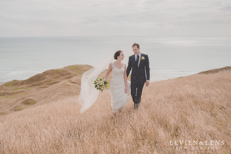 bride and groom walking Castaways - best wedding photos {Auckland New Zealand couples photographer}