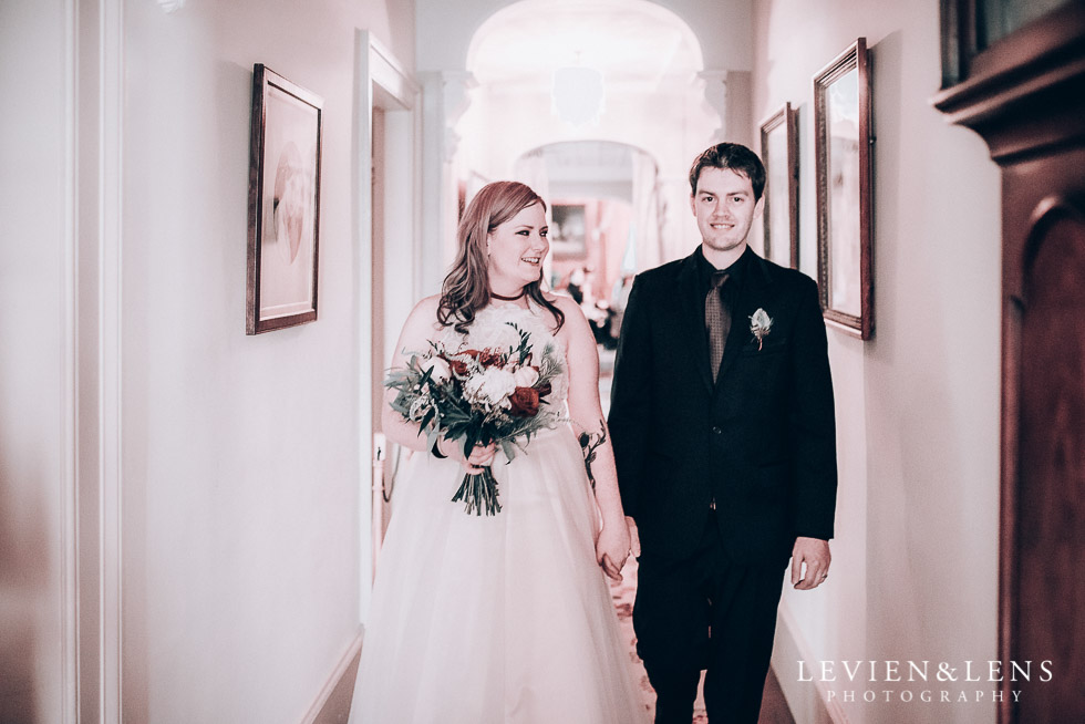bride and groom walking at aisle - Highwic historic house-museum winter wedding {Auckland NZ lifestyle weddings photographer}