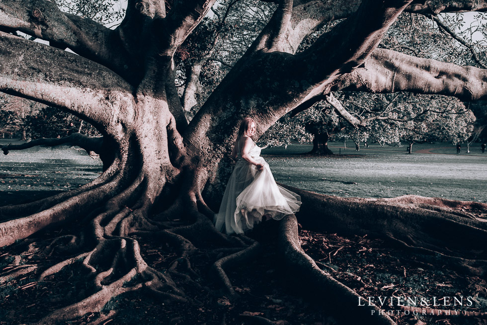 bride near big tree - Cornwall park photo session - winter wedding {Auckland NZ lifestyle weddings photographers}
