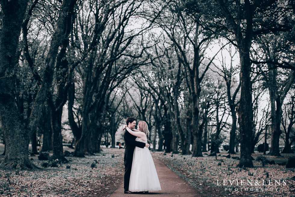 bride and groom at alley - Cornwall park photo session - winter wedding {Auckland NZ lifestyle weddings photographers}