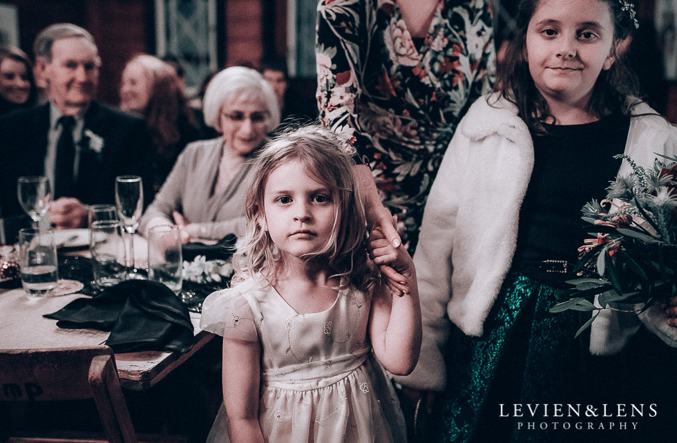 flower girls watching speeches - reception Highwic historic house-museum winter wedding {Auckland NZ lifestyle weddings photographer}
