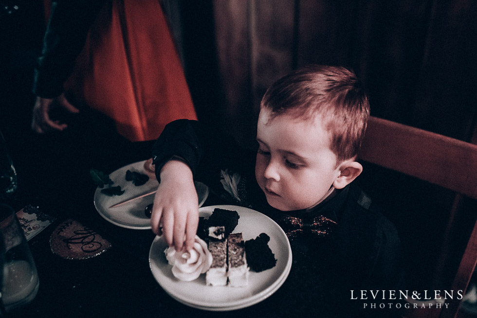 boy - ring bearer trying cake - Highwic historic house-museum winter wedding {Auckland NZ lifestyle weddings photographer}