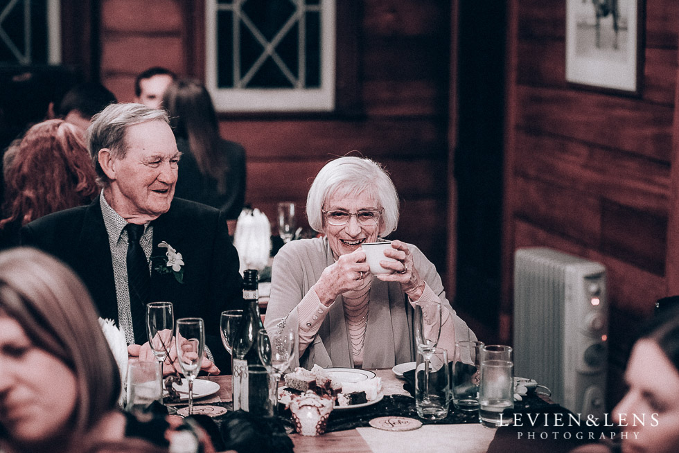 old guests laughing - reception tea - Highwic historic house-museum winter wedding {Auckland NZ lifestyle weddings photographer}