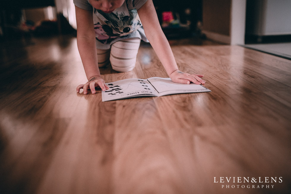 girl reading on the floor - August {Hamilton-Taupo lifestyle wedding photographer}