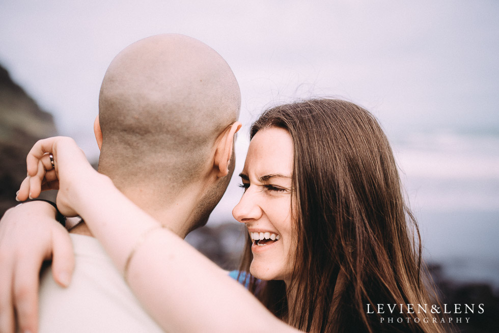 bride laughing - Muriwai Beach couples-engagement photo shoot {Auckland wedding photographer}