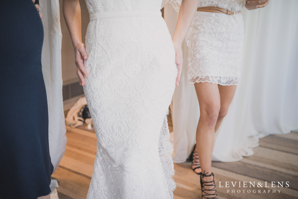 trying dress on - Bridal Show - High Tea by Trish Peng {Auckland wedding photographer} Sofitel Viaduct