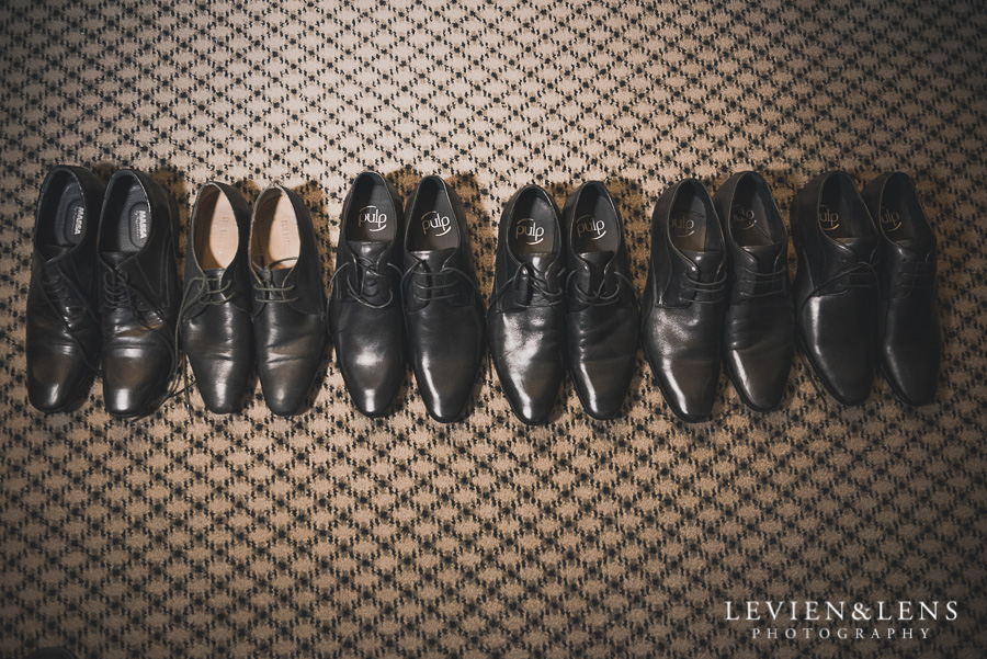 groom getting ready shoes - Langham Hotel Wedding {Auckland-NZ weddings photographers}