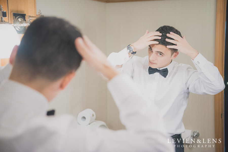 groom getting ready - Langham Hotel Wedding {Auckland-NZ weddings photographers}
