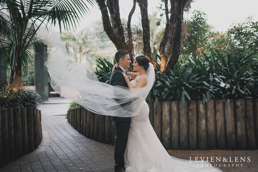 flying veil - bride and groom intimate session outside - Langham Hotel Wedding {Auckland-NZ wedding photographer}