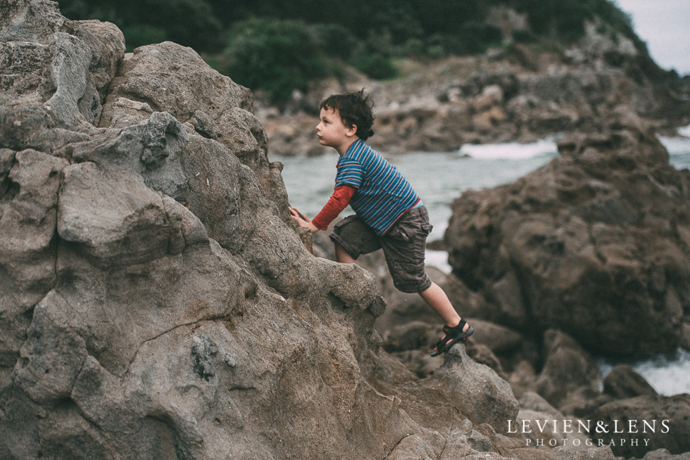 boy climbing on cliff - One little day in Tauranga - personal everyday moments {Hamilton NZ wedding photographer} 365 Project