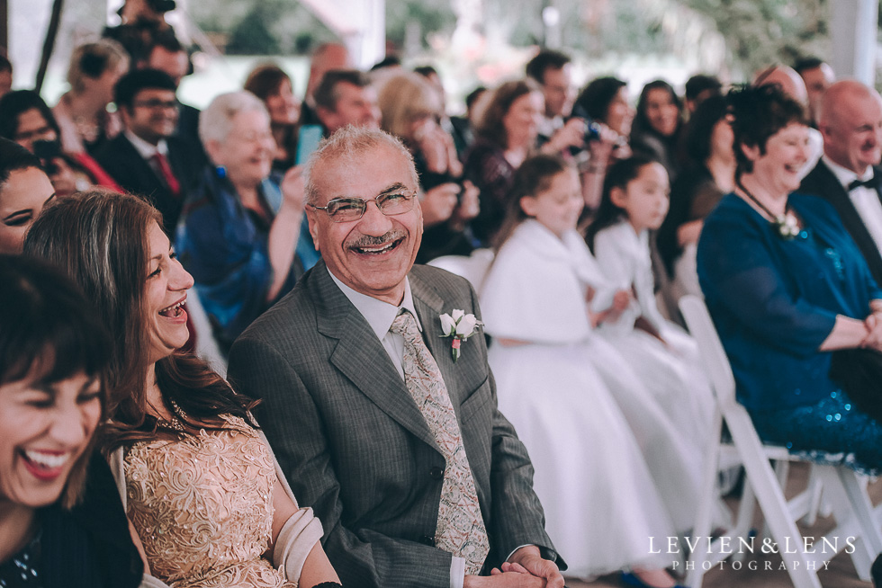 ceremony guests laughing - Markovina Vineyard Estate - Kumeu {Auckland wedding photographer}