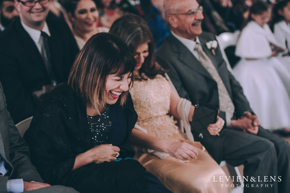 guests ceremony laughing - Markovina Vineyard Estate - Kumeu {Auckland wedding photographer}