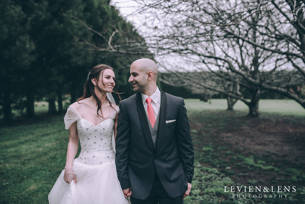 bride and groom walking - Markovina Vineyard Estate - Kumeu {Auckland wedding photographer}