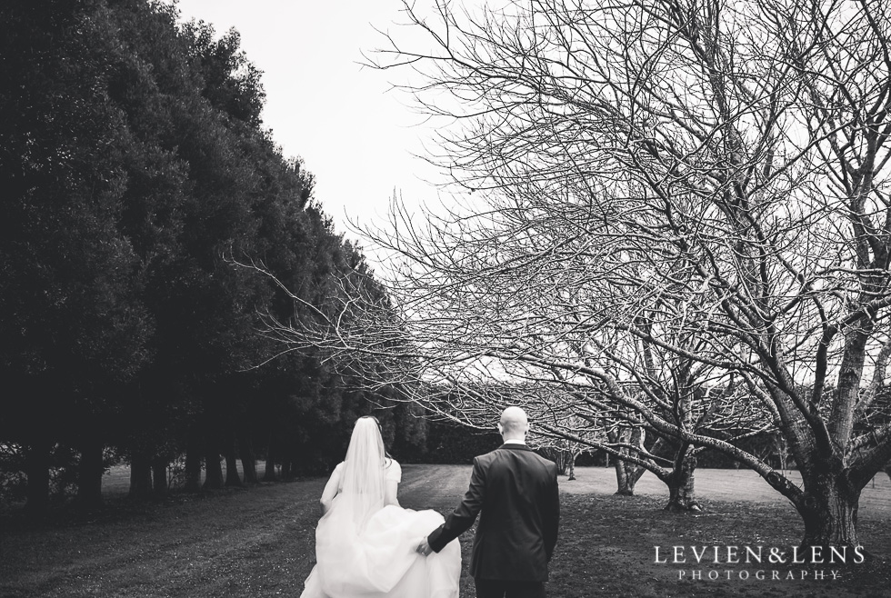 BW bride and groom walking - Markovina Vineyard Estate - Kumeu {Auckland wedding photographer}