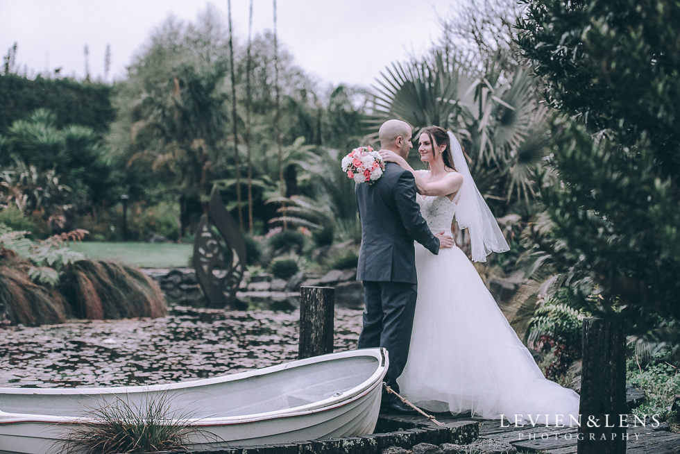 bride and groom near boat - Markovina Vineyard Estate - Kumeu {Auckland New Zealand wedding photographer}