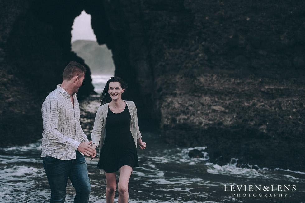 Run in the waves piha beach couples photo shoot auckland wedding engagement photographer