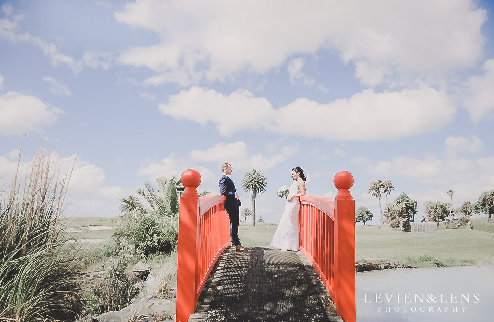 couple on red bridge - Formosa wedding Golf Resort {Auckland weddings photographer}