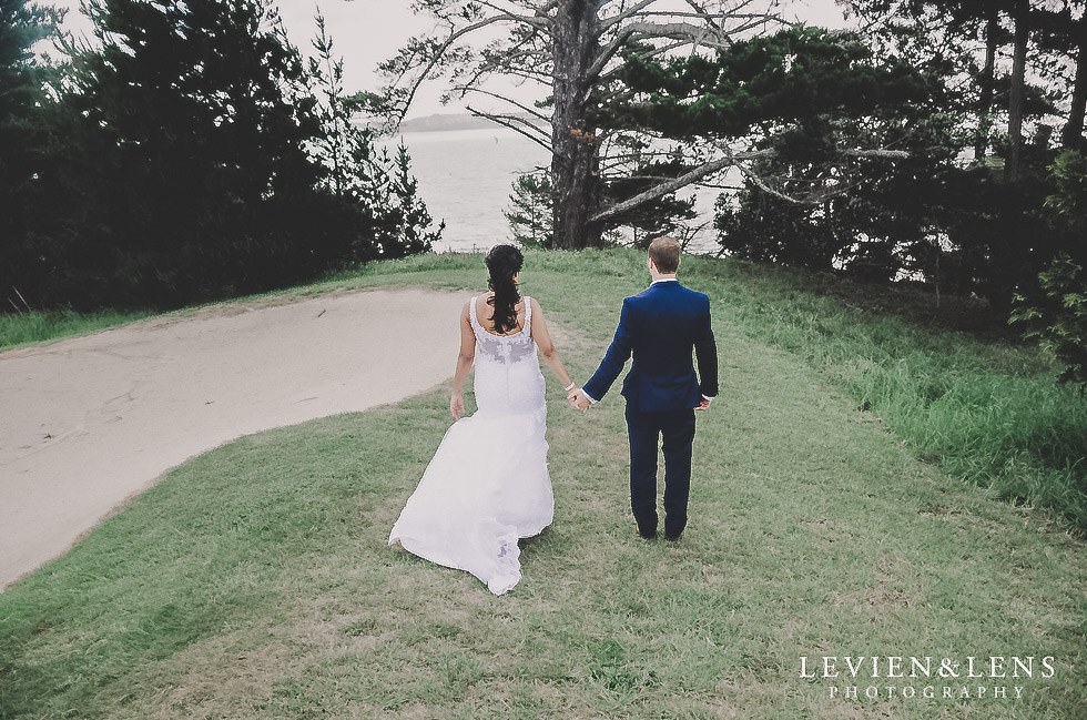couple walking holding hands - Formosa wedding Golf Resort {Auckland weddings photographer}