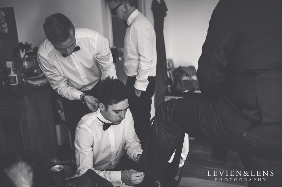 groom with groomsmen getting ready - New Zealand wedding photographer