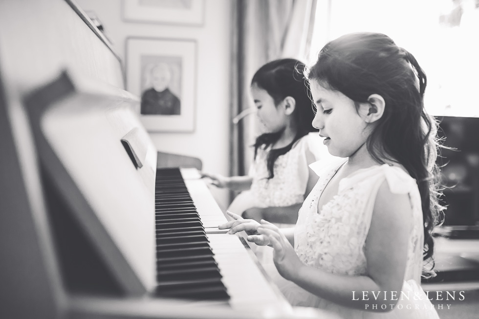 flower girls at piano - getting ready {Hamilton NZ wedding photographer}