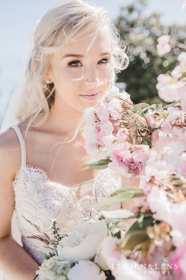 bride near pink flowers - portrait {New Zealand - Auckland wedding photographer}