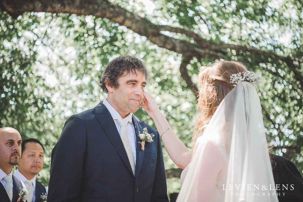 bride wiping grooms tears ceremony - Old Forest School Vintage Venue {Tauranga - Bay of Plenty wedding photographer}