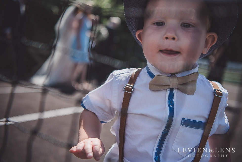boy at tennis net - Old Forest School Vintage Venue {Tauranga - Bay of Plenty wedding photographer}