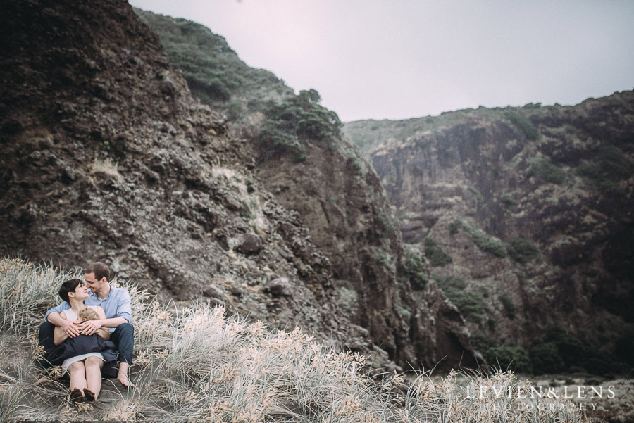 couple near cliff - Karekare Beach post-wedding | elopement photo shoot {Auckland NZ couples-weddings photographer}