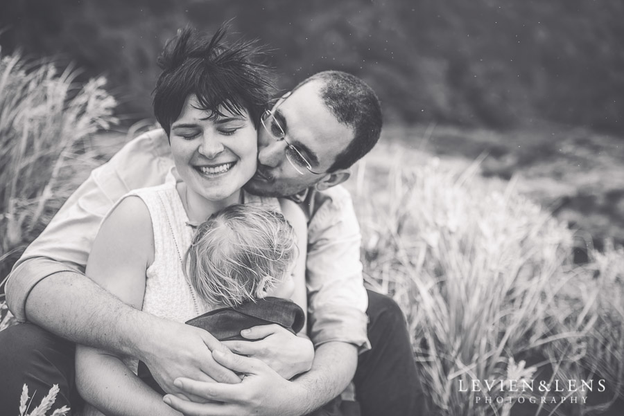 tender kiss moment - Karekare Beach post-wedding | elopement photo shoot {Auckland NZ couples-weddings photographer}