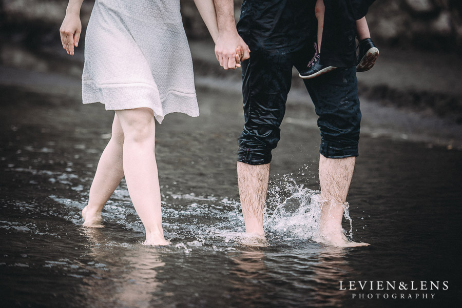 couple walking in water - Karekare Beach post-wedding | elopement photo shoot {Auckland NZ couples-weddings photographer}
