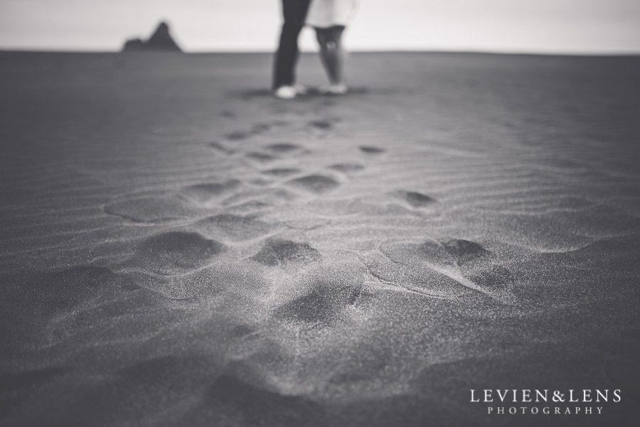 couple on sand - Karekare Beach post-wedding | elopement photo shoot {Auckland NZ couples-weddings photographer}