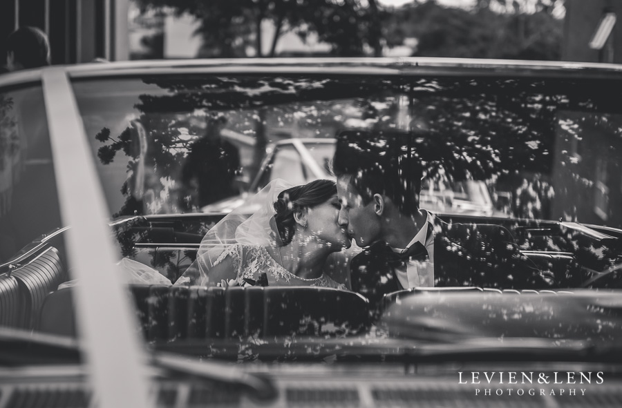 kiss in wedding car {Auckland wedding photographers} What to expect when second shooting at a weddings