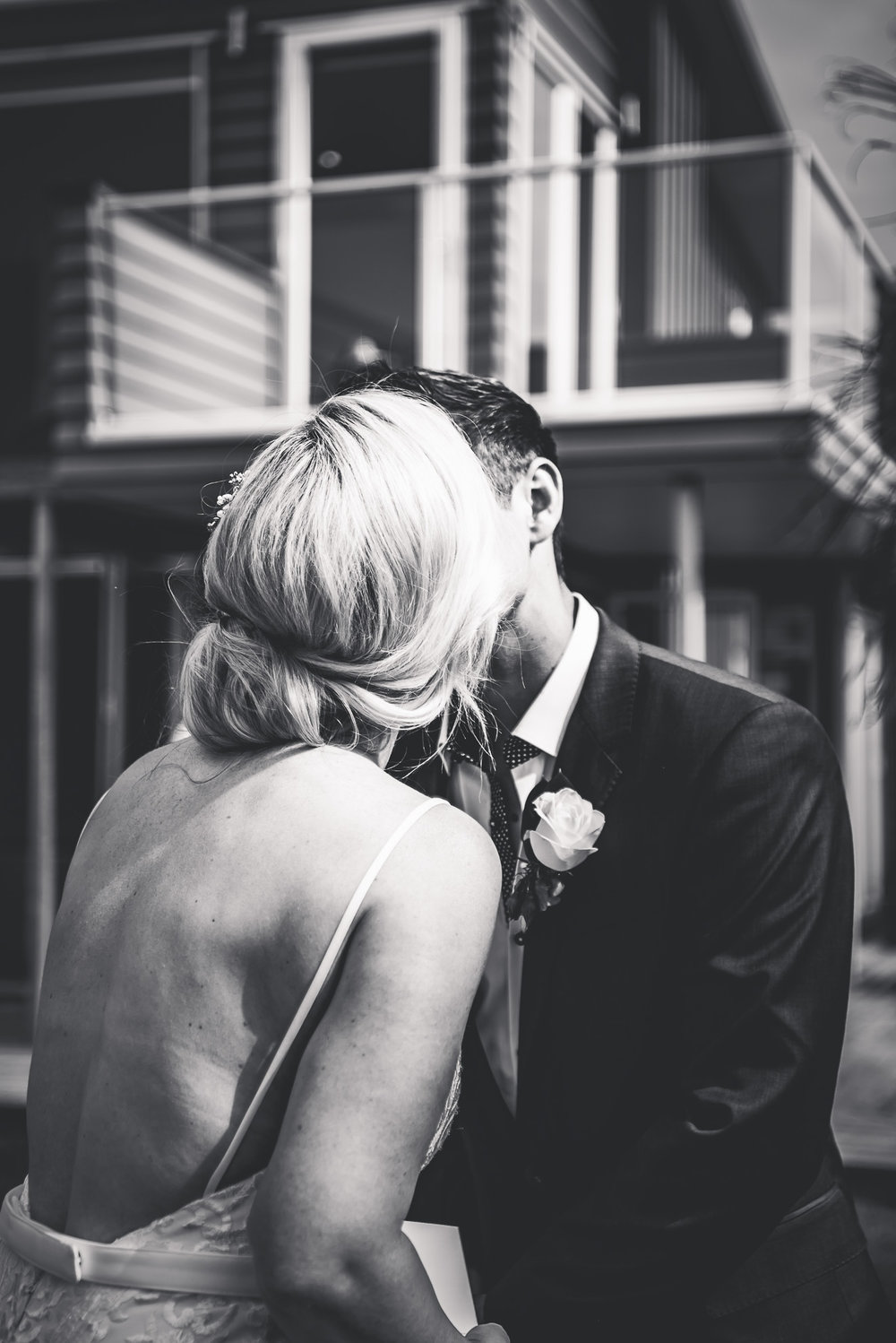 first kiss at ceremony - Waiheke island wedding {Wedding photographers in Auckland}