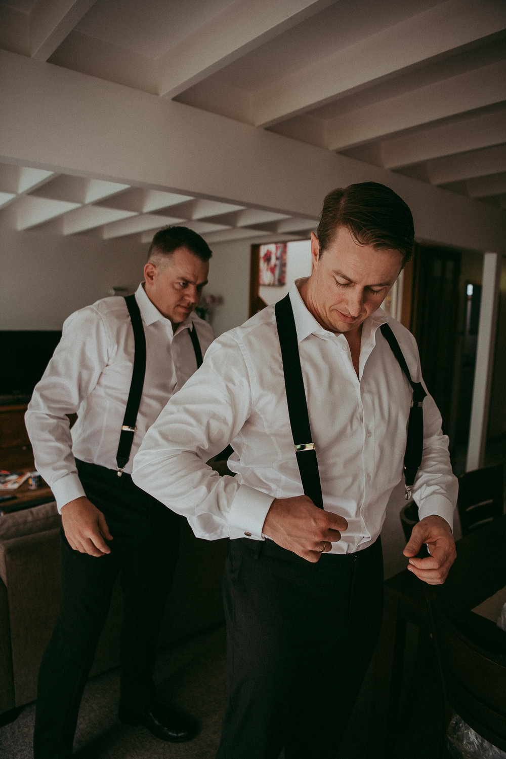 groom getting ready {top wedding photographers in Auckland - recommended first documentary}