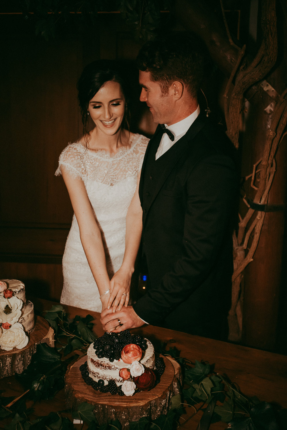 bride and groom cake cutting at reception - Markovina {West Auckland best wedding photographers}