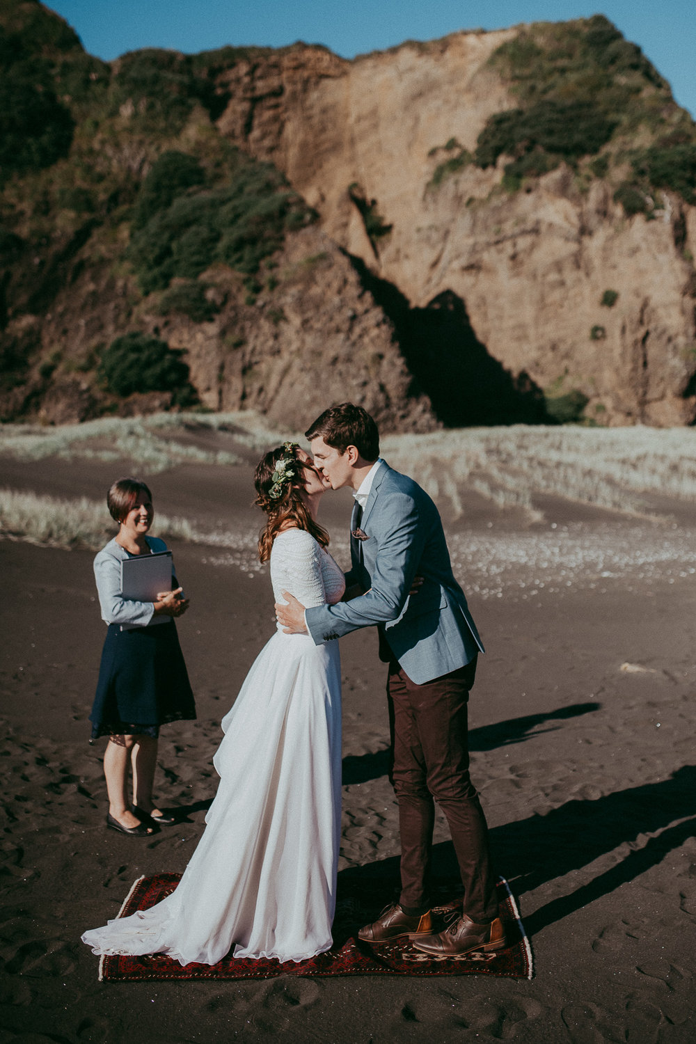 elopement - wedding ceremony on New Zealand beach - Auckland photographer