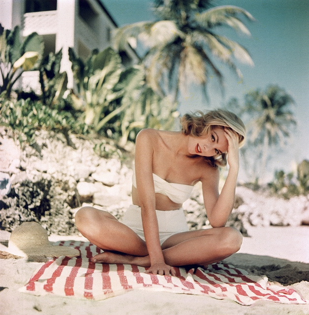 Grace Kelly photographed by Howell Conant in Jamaica, 1955.