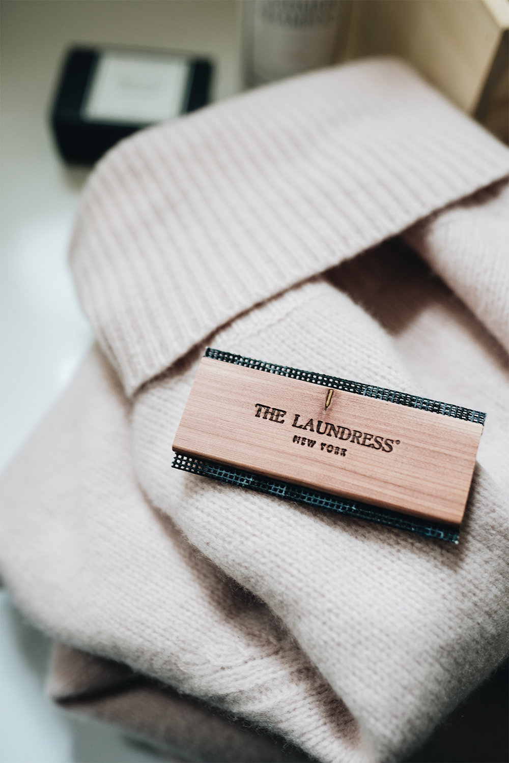 The Laudress Sweater Comb   The Laundress sweater comb easily removes pills from lightweight knitwear. Metal screens and cedar wood handle.