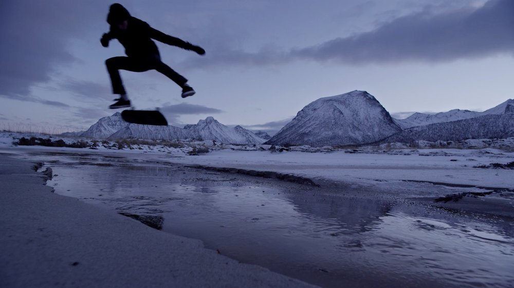 northbound-backside-kickflip-over-frozen-river-sand-skateboarding.jpg